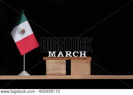 Wooden Calendar Of March With Mexico Flag On Black Background. Holidays Of Mexico In March.