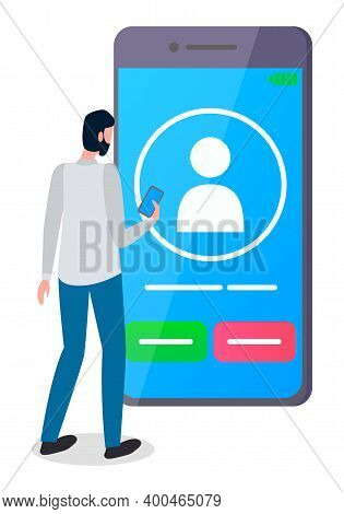 Man, Back View, Stands In Front Of Cartoony Huge Screen Smartphone With Flat Human Icon. Video Call.
