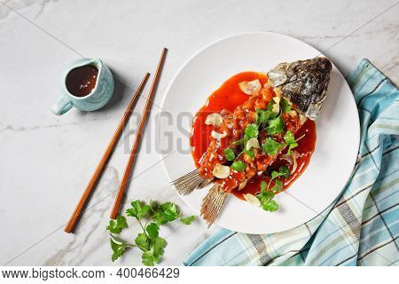 Chinese Food: Carp Squirrel Or Songshu Yu Under Sweet And Sour Sauce And Fresh Cilantro Served On A