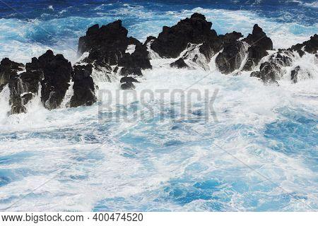 Rocky Ocean Shore. Sea Wave Background. Rocky Cliff Madeira Island Landscape. Water Foam On The Surf