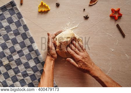 Hands Knead The Dough On Table, Top View. Homemade Cookies. Sun Beam On Hand, Cookie Cutters And Ing