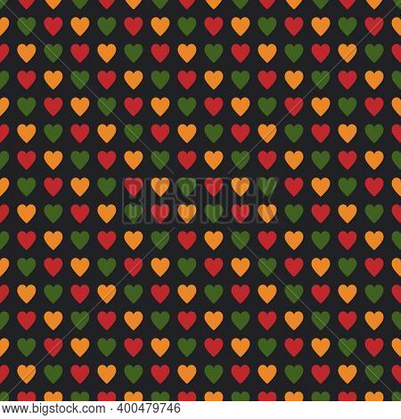 Seamless Pattern With Hearts In Traditional Pan African Colors - Red, Yellow, Green, Black Backgroun