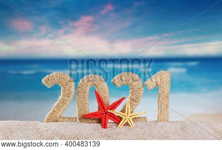 New Year Lettering 2021 Decorated With Starfish In The Sand On A Sunny Beach