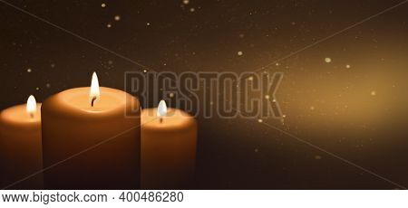 Several Burning Candles With Festive Bokeh On A Dark Gold Background. Banner With A Copy Of The Spac