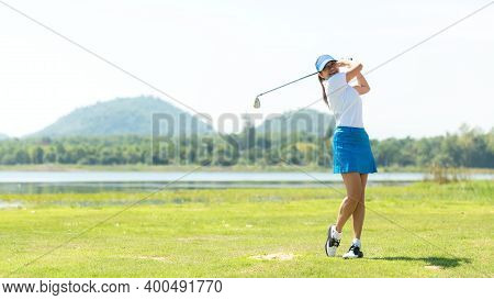 Golfer Sport Course Golf Ball Fairway. People Lifestyle Woman Playing Game Golf And Hitting Go On Gr