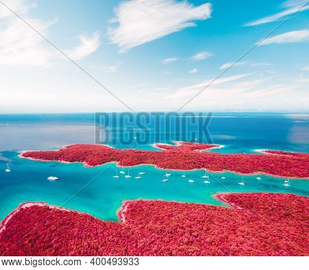 Fantastic color infra-red lagoon on sunny day. Location Kvarner Gulf, Punta Kriza, Cres island, Croatia, Europe. Drone photography. Artistic style picture. Art photo wallpaper. Wonders of the world.