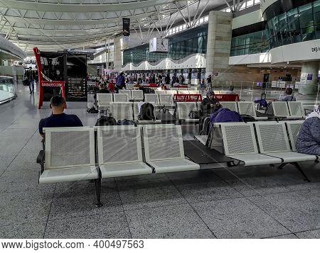 Turkey, Ankara - October 24, 2019: Lobby At Ankara Esenboga Airport. Tourists Sit On Metal Seats In