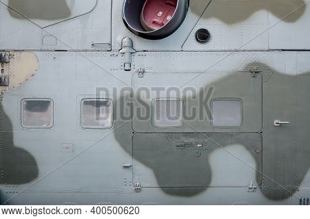 Side Part Texture Of Military Helicopter Painted In Camouflage. Old Armoured Aircraft