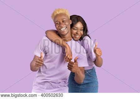 Funky Black Guy And His Girlfriend Hugging And Showing Thumbs Up, Recommending Something Over Lilac