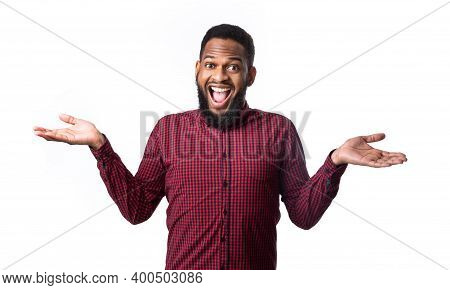 Excited African American Man Shouting Smiling Looking At Camera Posing Gesturing With Hands Standing