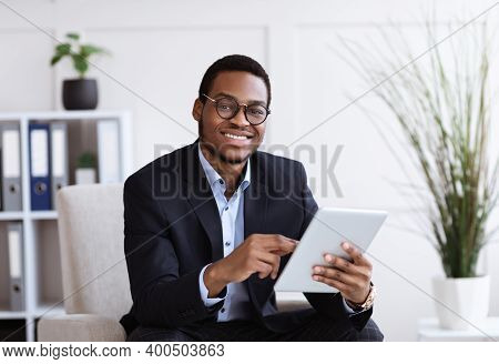 Smiling Black Manager In Suit Young Man Holding Digital Tablet, Using Modern Technologies In Busines