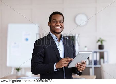 Smiling Black Entrepreneur Young Man Holding Digital Tablet, Using Modern Technologies In Business,