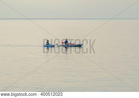 New Orleans, La - July 29, 2013: Two Men In Kayaks  Pause On Lake Pontchartrain On July 29, 2013 In