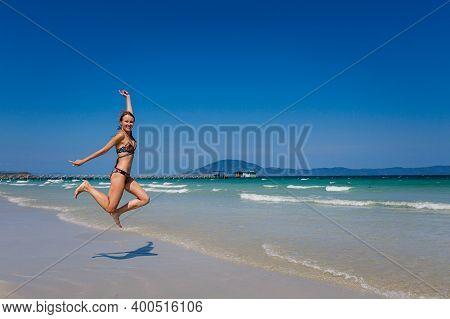 Smiling Woman On Wild Beach Vietnam