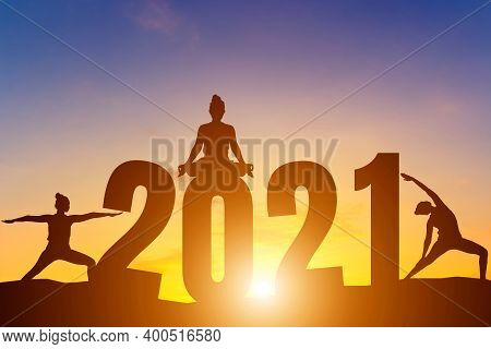 Happy New Year Numbers 2021, Silhouette Woman Practicing Yoga Early Morning Sunrise Over The Horizon