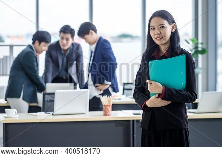 Successful Company,executive Young Asian Businesswoman With Hold File Folder With Happy Workers Grou