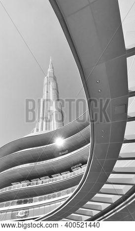 Dubai, UAE - February 01, 2020: Architectural shot of The Dubai Mall and Burj Khalifa building, United Arab Emirates. Black and white photography