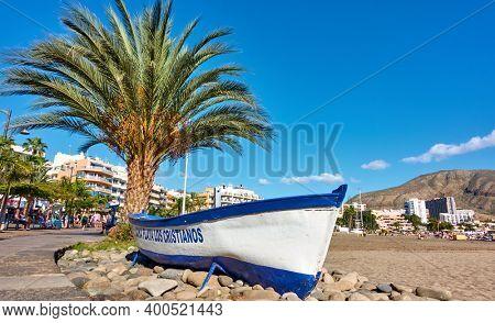 Los Cristianos, Tenerife, Spain - December 12, 2019: Waterfront and sandy beach in Los Cristianos, Tenerife Island, The Canaries