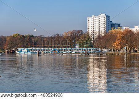 Berlin, Germany - November 8, 2020: Lake Tegeler See With The Riverboat Station At A Shore Trail Gre