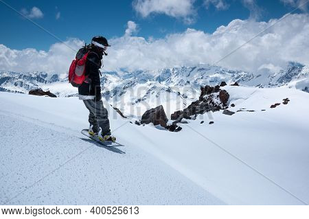 Young Woman Snowboarder Stands On A Snowboard On The Slope Getting Ready To Roll Freeride Backcountr