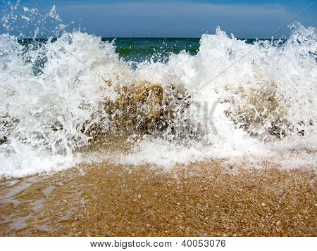Marine waves on the sand of sea coast