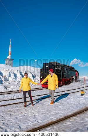 Couple Men And Woman Hiking In The Harz National Park Germany, Steam Train On The Way To Brocken Thr