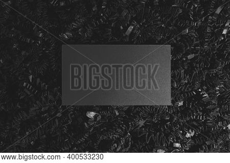Business Concept. Black Business Card Templates With Copy Space Placed On Shredder Black Curly Carto