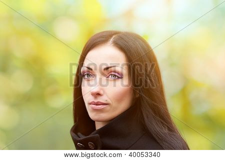 Young Woman On The Spring Background