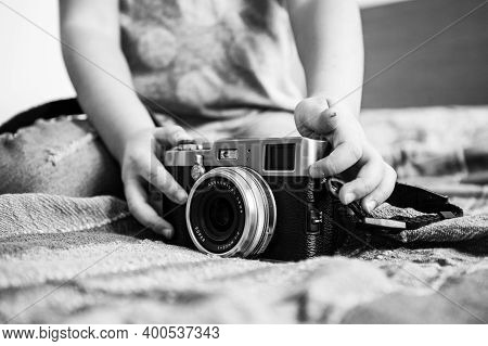 Close Up Of A Mirrorless Retro Camera On The Blanket - Little Girl Playing With Camera - Talented Li