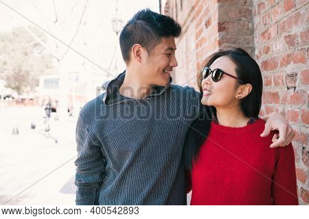 Portrait Of Young Asian Couple In Love