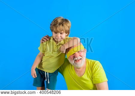 Family Sport Game. Family Workout Together. Family Sport. Portrait Of Grandfather And Grandson Worki