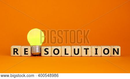 Resolution Symbol. Wooden Cubes With Word 'resolution'. Yellow Light Bulb. Beautiful Orange Backgrou