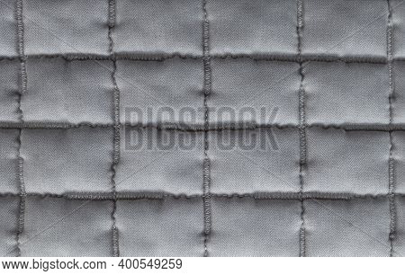 Sewed Quilt Blanket Texture. Gray Quilted Cotton Duvet Patchwork. Soft Sewing Plaid Fabric Close-up.
