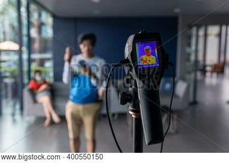Thermal Scanner To Check The Temperatures Of Passengers Arriving Airport. Automatic Measuring Temper
