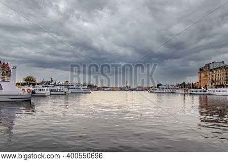 Beautiful Tranquil Winter City Scene With Water, Ships  And Dramatic Sky In Stockholm Sweden.