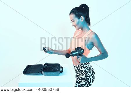 Percussion Handheld Massager, Athletic Young Girl Choose Attachments In Suitcase For Massaging Gun I