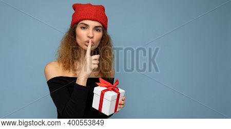 Attractive Happy Young Dark Blonde Curly Woman Isolated Over Blue Background Wall Wearing Stylish Bl