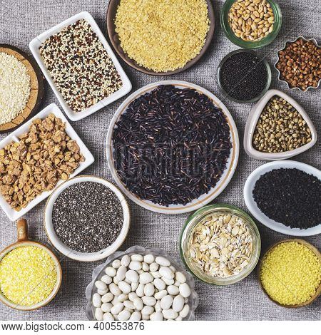 Food Background Of Various Cereals And Grains In Plates On A Canvas