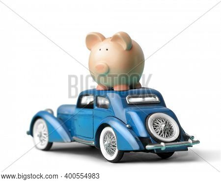 vintage car model with a piggy bank on top