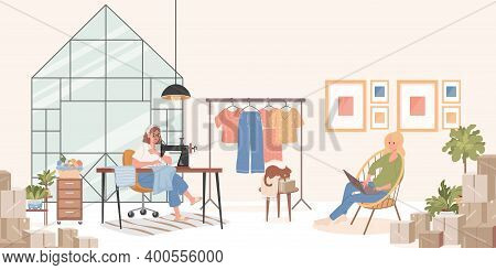 Sewing Workshop Interior Concept. Tailor Or Dressmaker Sews Clothes On Sewing Machine, Young Smiling