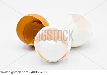 White And Brown Broken Egg Shells, Cracked Egg Shells, Isolated On White Background