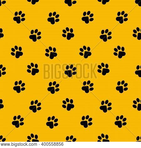 Seamless Pattern With Cat Paw Prints On A Yellow Background For Fashion Prints, Bed Linen, Textiles,