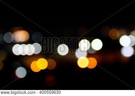 Light Night City Bokeh Abstract Background Glittering Stars On Bokeh. Orange Bokeh In The Bottom Of