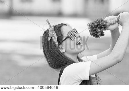 Summer Song. Happy Girl Hold Flowers As Microphone. Flower Shop. Flower Arranging. Floral Shop. Cele