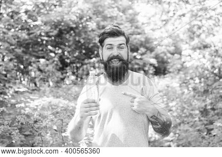 Guy With Moustache Drink Water. Mature Bearded Man Pointing Finger. Summer Camping Vacation. Man Hip