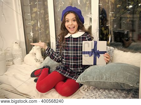 Advertising Product. Happy Child Show Product With Hand. Presenting Holiday Gift. Christmas Advertis