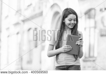 Nourishing Desire To Information. Happy Girl Hold Book Outdoors. Information And Knowledge. School L