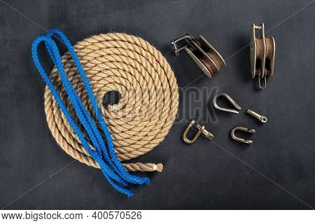 Thick Jute Rope, Two Pulleys And A Shackle. Sailing Accessories Used On Yachts.