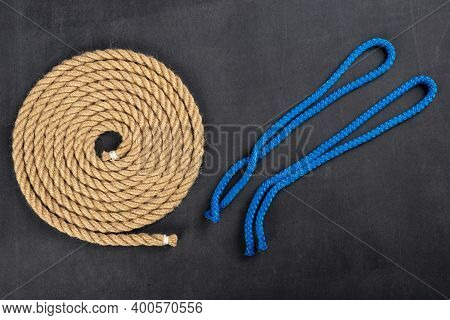 Thick Jute Rope Coiled Into A Circle And Short Lines For Tying The Sails. Sailing Accessories Used O
