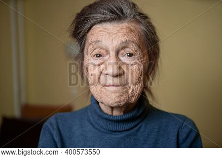 90 Year Old Cute Elderly Woman With Gray Hair And Wrinkles Face, Wearing Sweater, Portrait Large, Sm